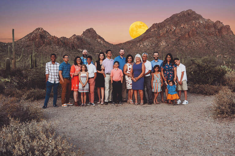 The Castillo family all together with Gates Pass in the background and June's rising Strawberry Moon.