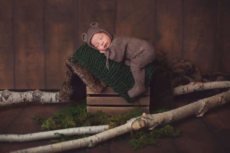 Baby Jackson was cozy in his bear onesie during his newborn session in Tucson