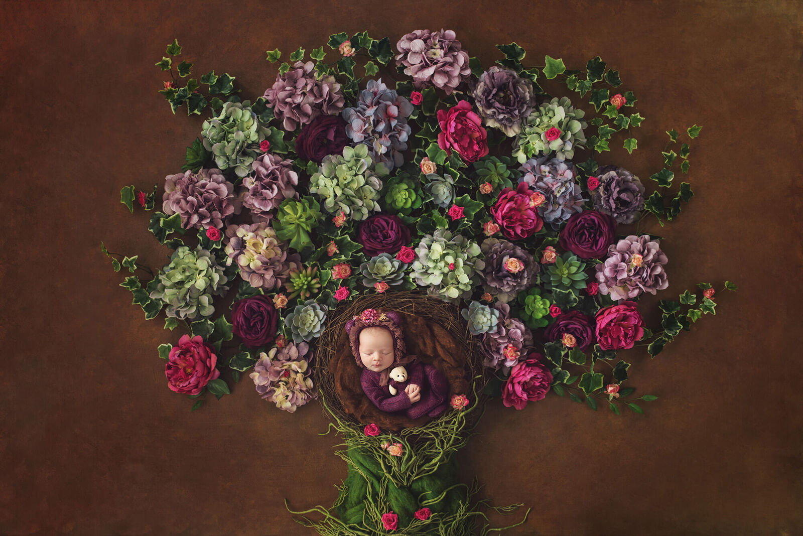 Newborn girl in a colorful floral tree of life by Wiesbaden newborn photographer