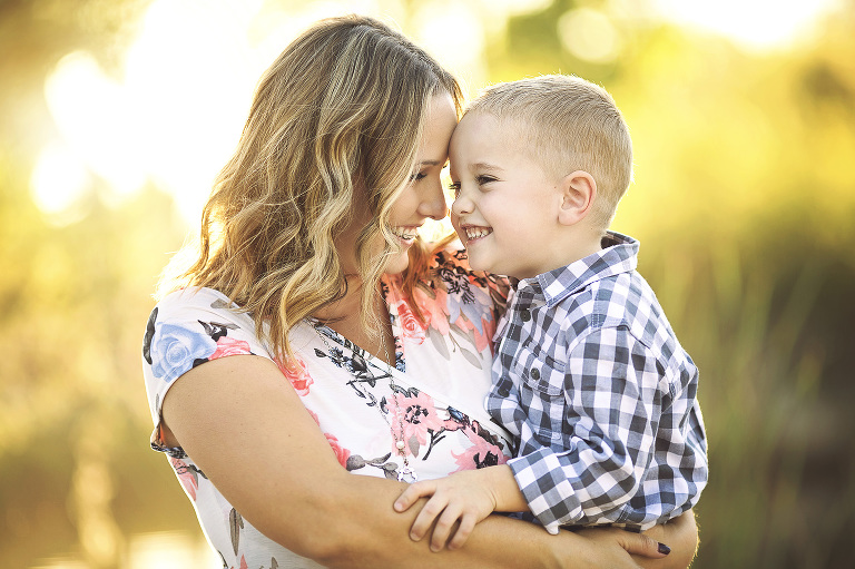 Mom and son share a giggle moment during their family photo session at Tanque Verde Guest Ranch Ranch in Tucson.