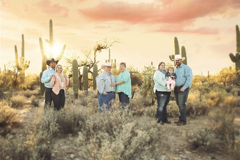 Family with daughters' husbands for a multi family sunset session at Sabino Canyon amongst the desert saguaros of Tucson.