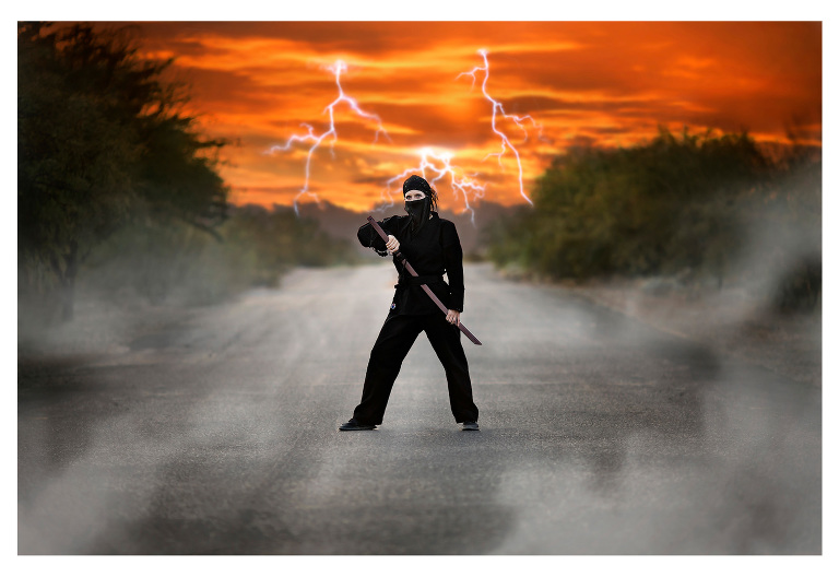 Halloween photo of a mom wearing her ninja attire with fog and lightning