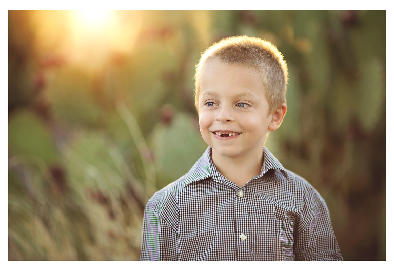 Christmas photoshoot in Tucson with a little boy and prickly pear cactus at sunset