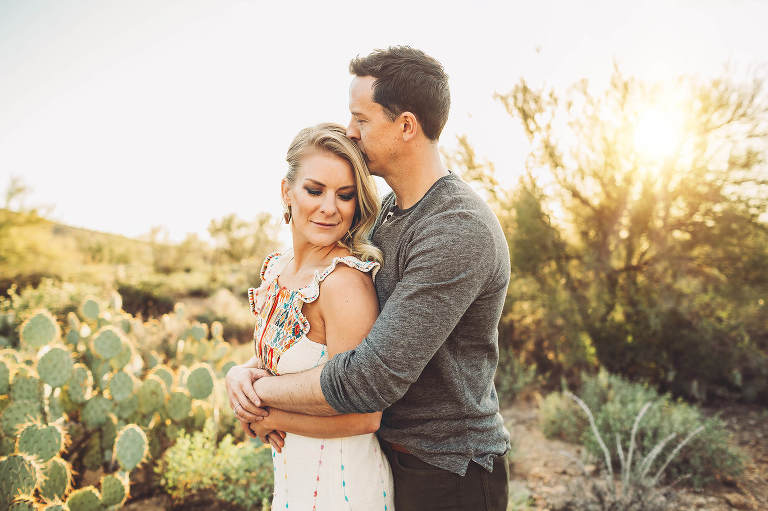 A couple cozies up at sunset during their family photo session in Tucson