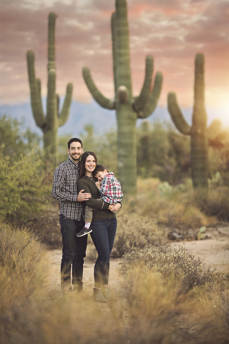 Tucson family standing amidst the majestic saguaros of Sabino Canyon during a family holiday photo session in Tucson