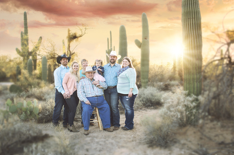 Rays of sun peak from behind the saguaros to illuminate this family of seven during their sunset family photo session at Sabino Canyon in Tucson.