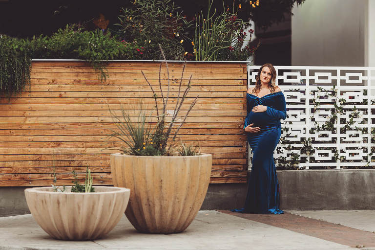 A maternity session outside of a downtown Tucson nightclub