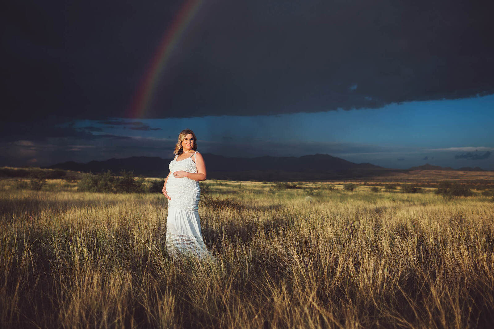 A summer storm in Sonoita produces a rainbow during a breathtaking maternity session