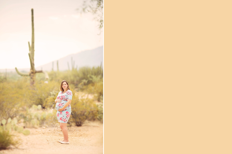 A pregnant mom gazes at the camera holding her belly wearing a feminine floral dress during her maternity session at Saguaro National Park