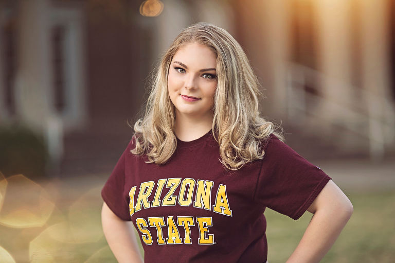 Miss Olivia stands proudly wearing her Arizona State University t-shirt during her senior portrait session