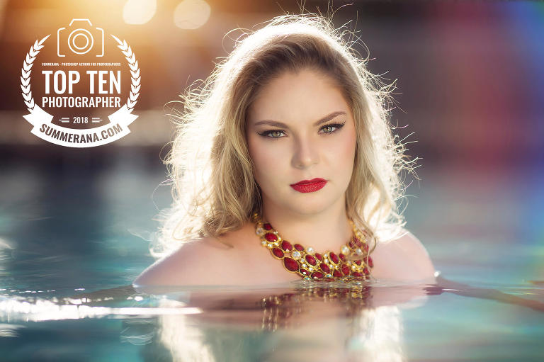 A glamorous senior photo session ends with sunset pool photos in Tucson