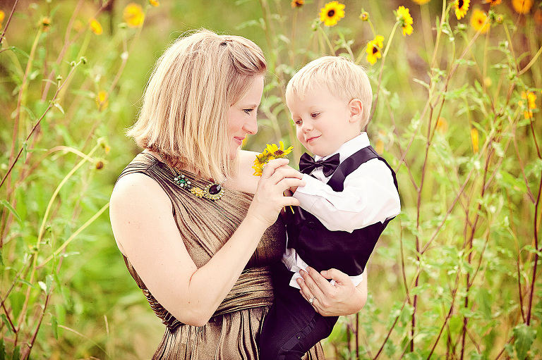 A photo of my son and I five years ago playing with wild sunflowers