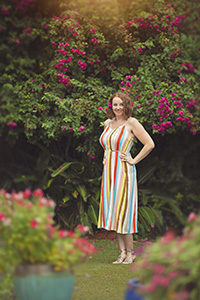 Mandy, a phoenix blogger, stands amongst brilliant bougainvillea and garden flowers at the Hacienda Del Sol resort in Tucson
