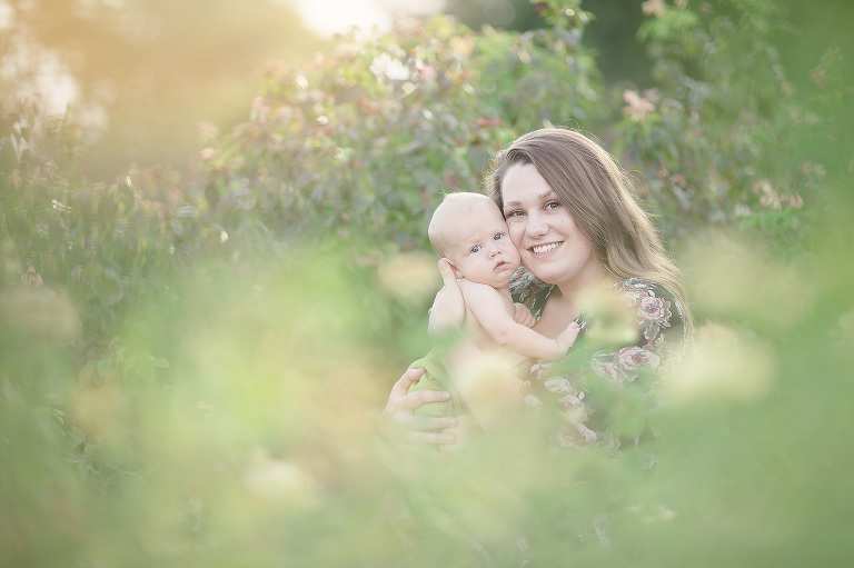 A breastfeeding mom cuddles her baby son at sunset during her breastfeeding session at Reid Park's rose garden in Tucson