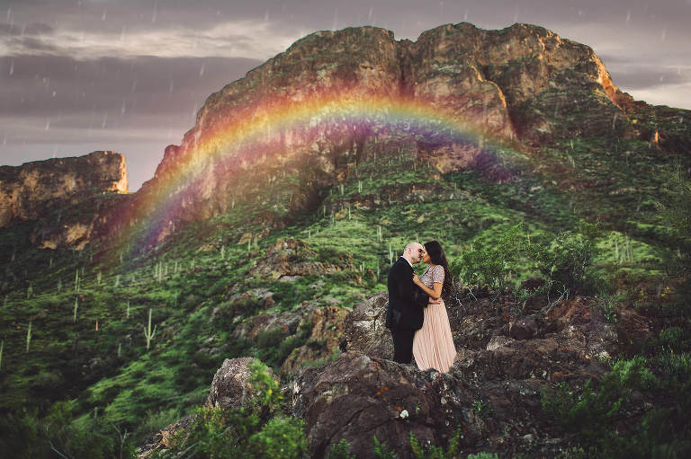 An engagement session turned magical evening with mountain rainbows in Arizona