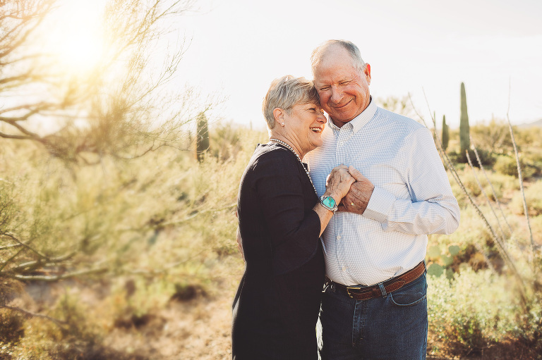 Husband and wife celebrating their anniversary with a desert photoshoot in Tucson