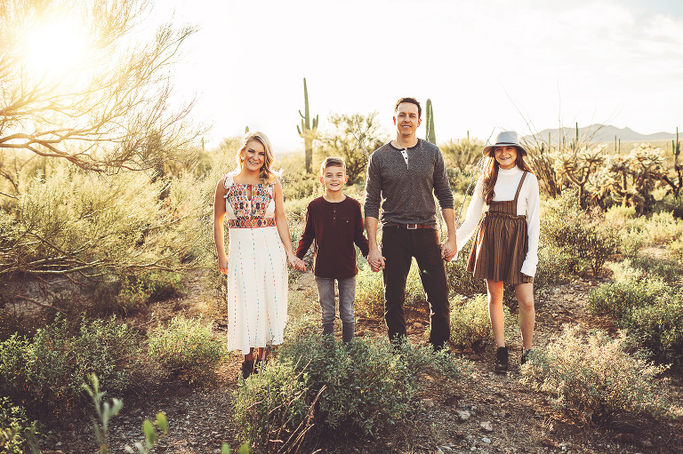 A family enjoys a beautiful winter evening in the desert during their sunset family shoot with Belle Vie Photography