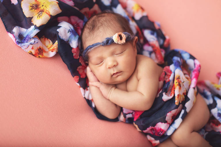 Baby Valentina during her newborn session with Tucson newborn photographer wrapped in a floral scarf