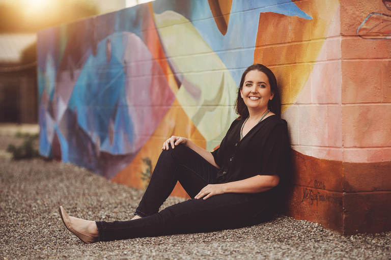 Megan during her headshot session at one of Tucson's beautiful mural walls