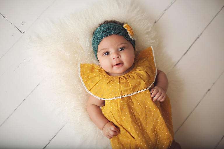 Yellow and teal were beautiful colors for baby Aari during her three-month milestone session.