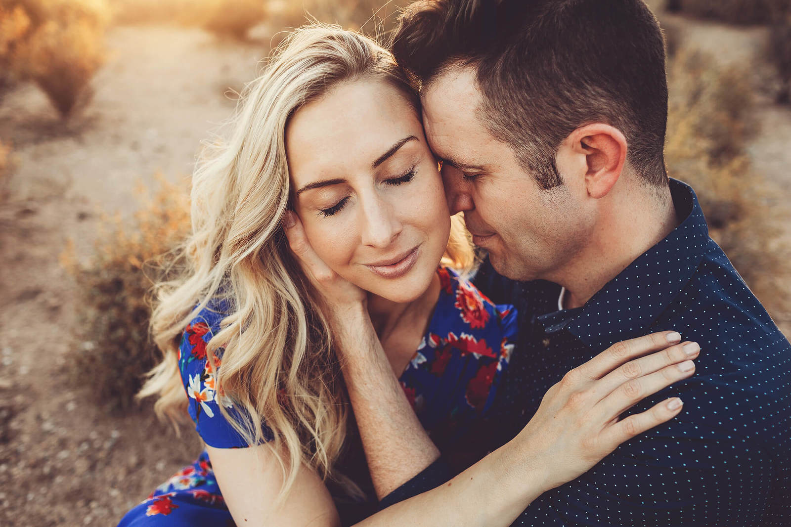 A loving embrace surrounded by golden Tucson sunlight during an engagement session