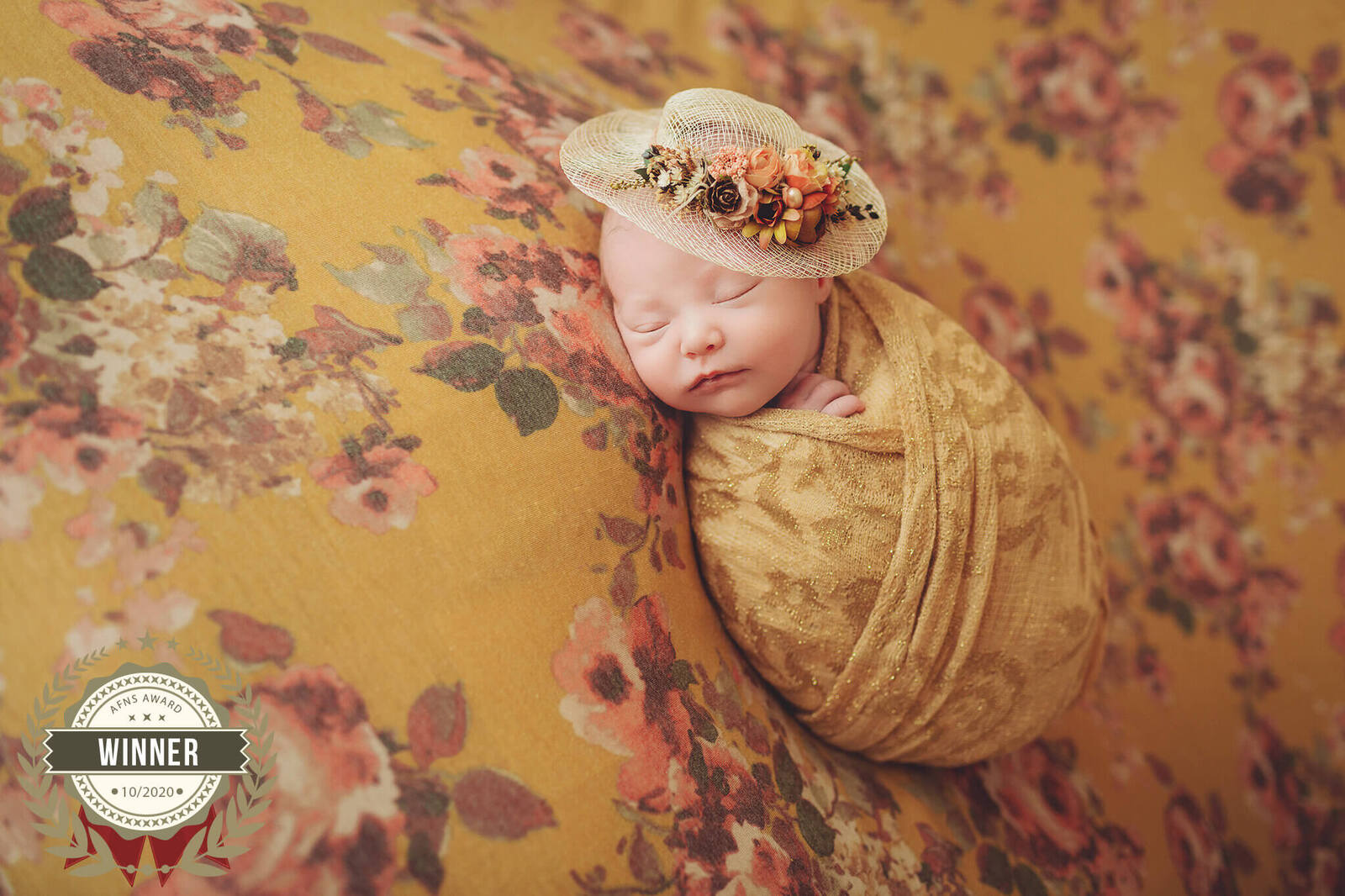 AFNS award a newborn baby girl in yellow floral with a tiny hat